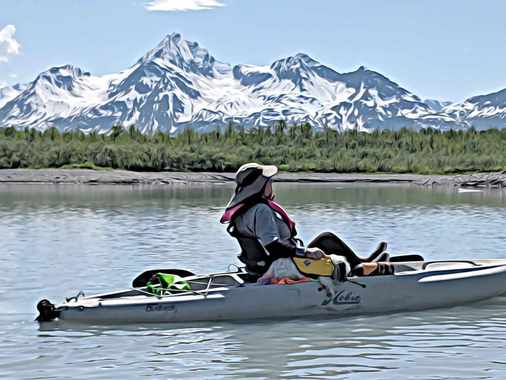 Alaska Kayaking around snow covered mountains on Glacier Lake