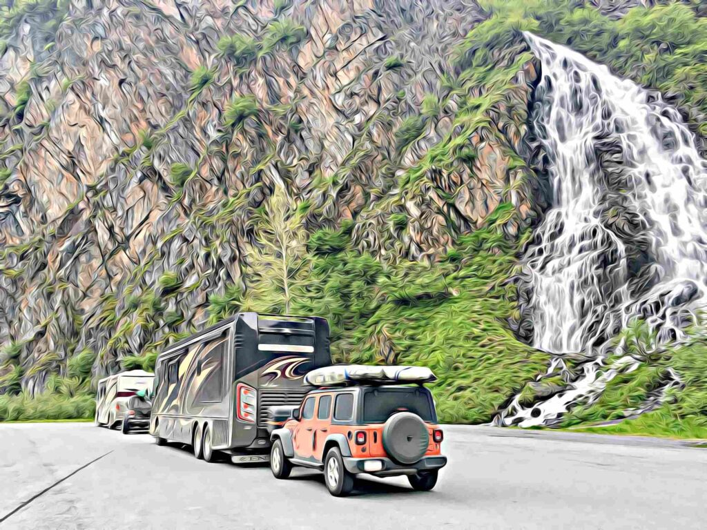 Valdez Alaska Motorhomes parked beside large waterfall